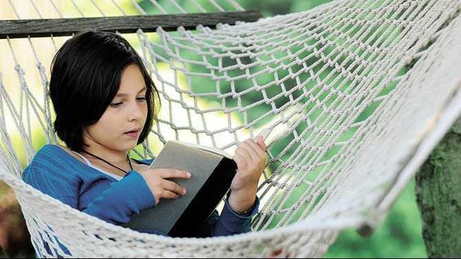 Girl reading in hammock N1008P13001C